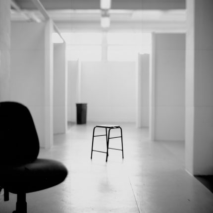 Lizzie King & Craig Tattersall, Studios (2015). Image courtesy of artists. Photograph of swivel chair in foreground and a stool in the centre of the shot in a deserted artist studio.