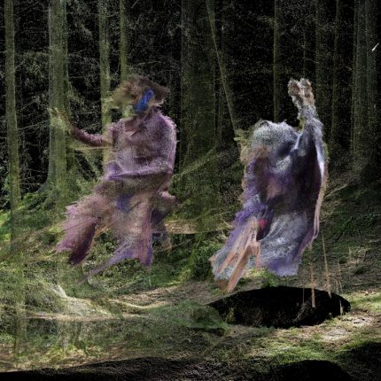 Still from 'Where the City Can't See'. Courtesy of Liam Young. Photograph shows two figures dancing in a forest.