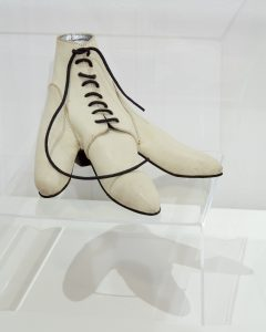 A white leather laced shoe designed for a bird's foot.