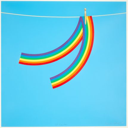 Blue background. Foreground a rainbow pegged on a washing line.