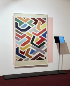 Painting of blocked shapes in various colours.