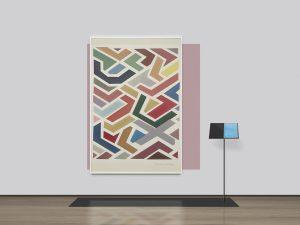 Abstract painting of block colours hanging on a wall with a book on a stand to the right.