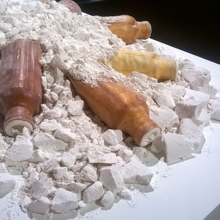 Crumbed plaster with latex bottles arranged on the pile.