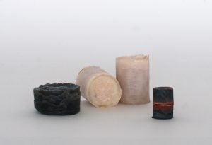 Four cylindrical objects made of salt.