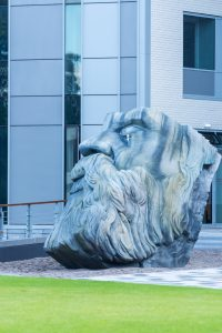 Photograph of an outdoor sculpture of the head of Friedrich Engels.
