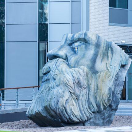 Photograph of an outdoor sculpture of the head of Friedrich Engels.